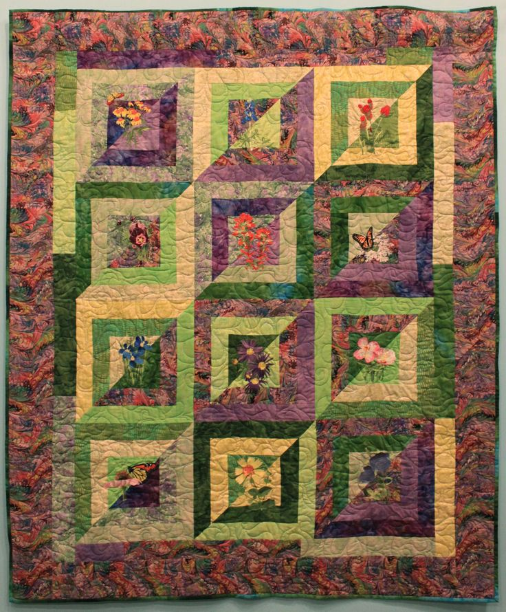 "Wall Hanging 5, ""Texas Wildflowers"" by Barbara Wiggins  ""Living in Texas for eight years gave me the opportunity to see the many seasonal wildflowers native to that area. This quilt shows many of them just as if they were blooming along the roadside or in a pasture."""