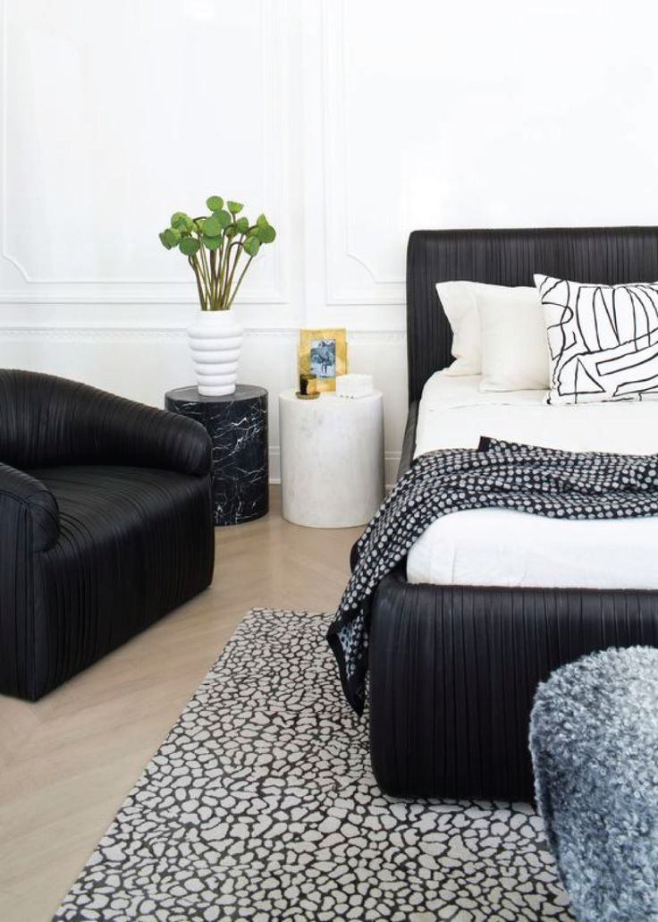 Black Leather Bed with White Bedding
