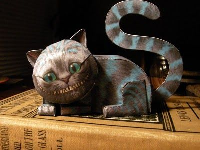 Origami-ish paper cheshire cat =)  Can download the file to print the kitty to paper and then fold him up!