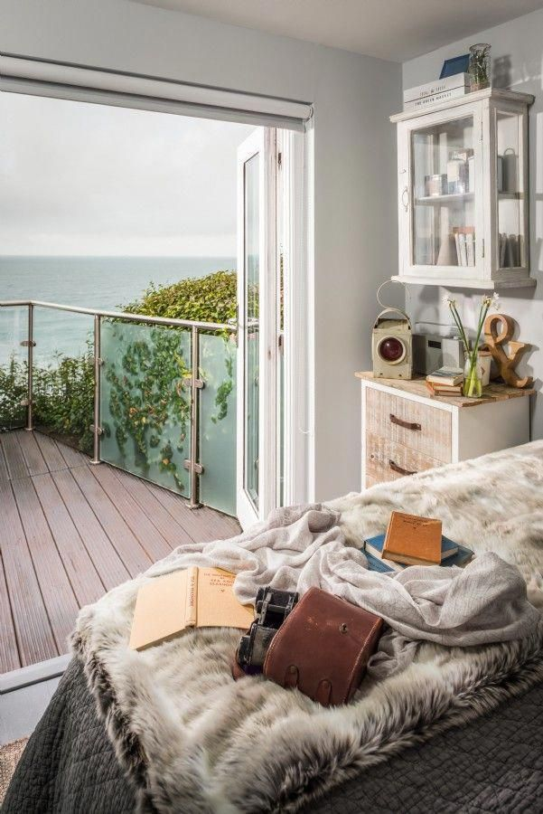 c6b9712a4b54 love this seaside interiors vintage rustic bedroom with modern balcony  terrace. Click through for more seaside coastal bedroom idea…