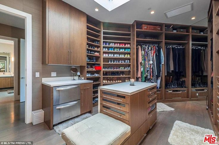 Dreamy dresses: The walk-in wardrobe is a stand-alone masterpiece that rivals Carrie Brads...