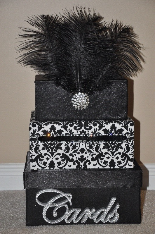 Making a pink and zebra one for my graduation card box with pink,white, and black feathers!