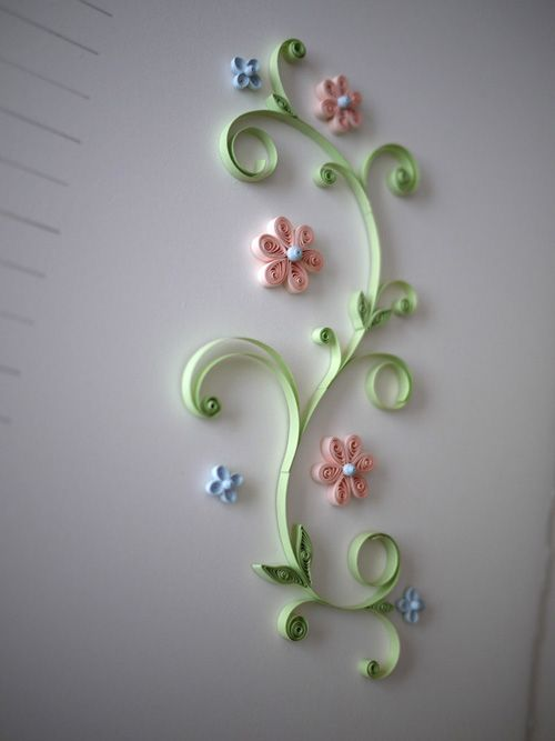 Each wedding invitation featured quilled flowers. Visual and textured interest.