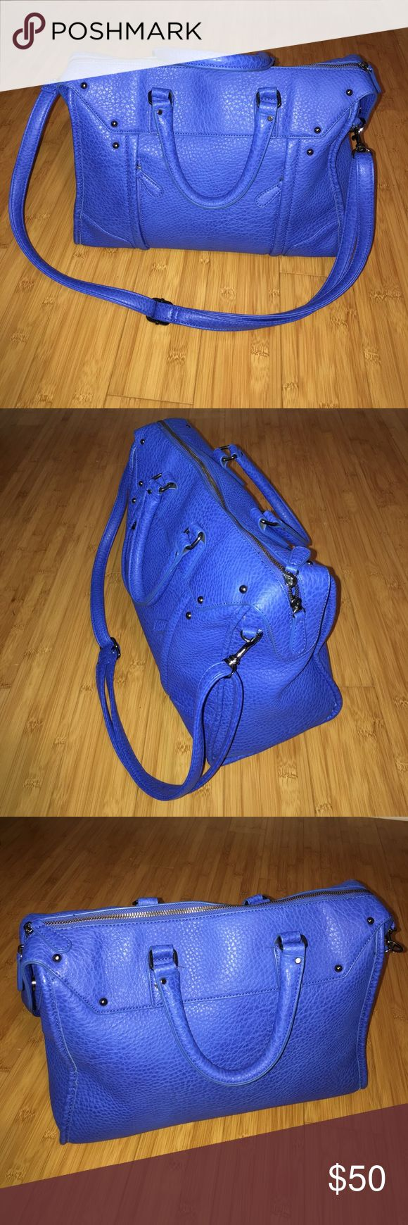 """Blue Tote Bag Blue Crossbody Tote Bag. It has two front pocket and two inside pocket. Color: Blue Closure: Zipperfly Pre-owned. Well taking care of. Just like new.  Measurements: Handle: 14"""" inches Crossbody strap:  53"""" inches Height:  31cm Depth: 13cm Width: 15"""" inches  Bundle and save. Reasonable offers are welcome. JustFab Bags Totes"""
