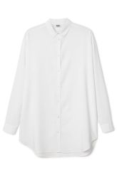 This is a button-down shirt in a soft viscose material. It has long, button-up sleeves and a curved hem. In a size small this shirt measures 83 cm in length and 112 cm around the chest. The sleeve length is 54 cm.