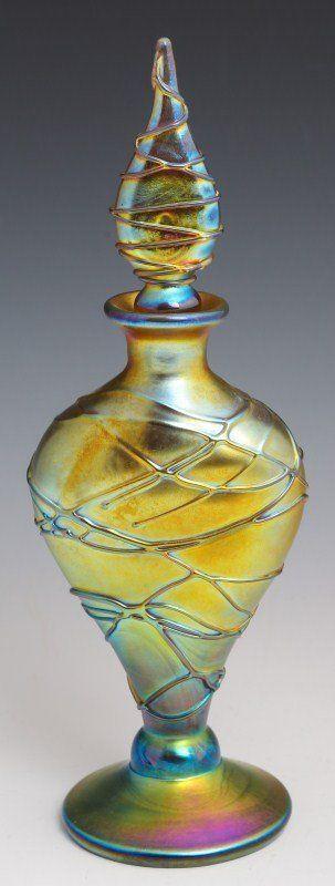 STEVEN LUNDBERG PERFUME BOTTLE. GOLD IRIDESCENT PERFUME BOTTLE WITH SPIDER WEBBING ALL AROUND. CIRCA 2002