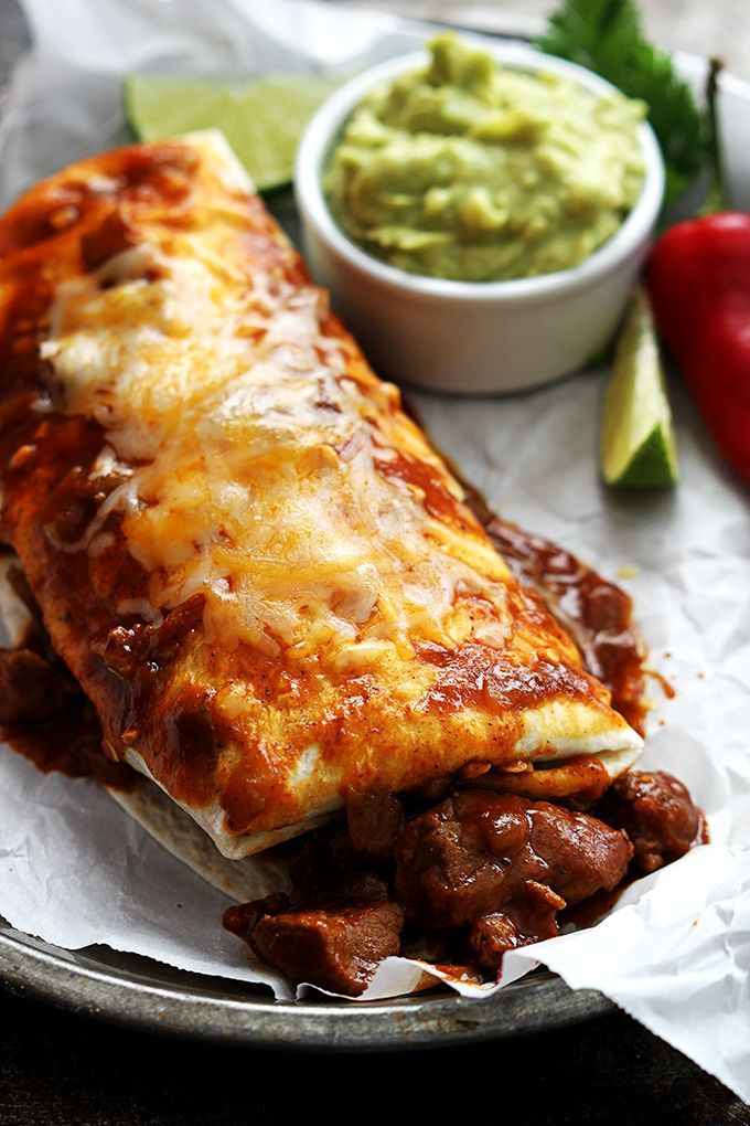 Saucy, cheesy smothered chile colorado burritos made in 30 minutes. The sauce is so good you'll want to eat it straight from the pan.