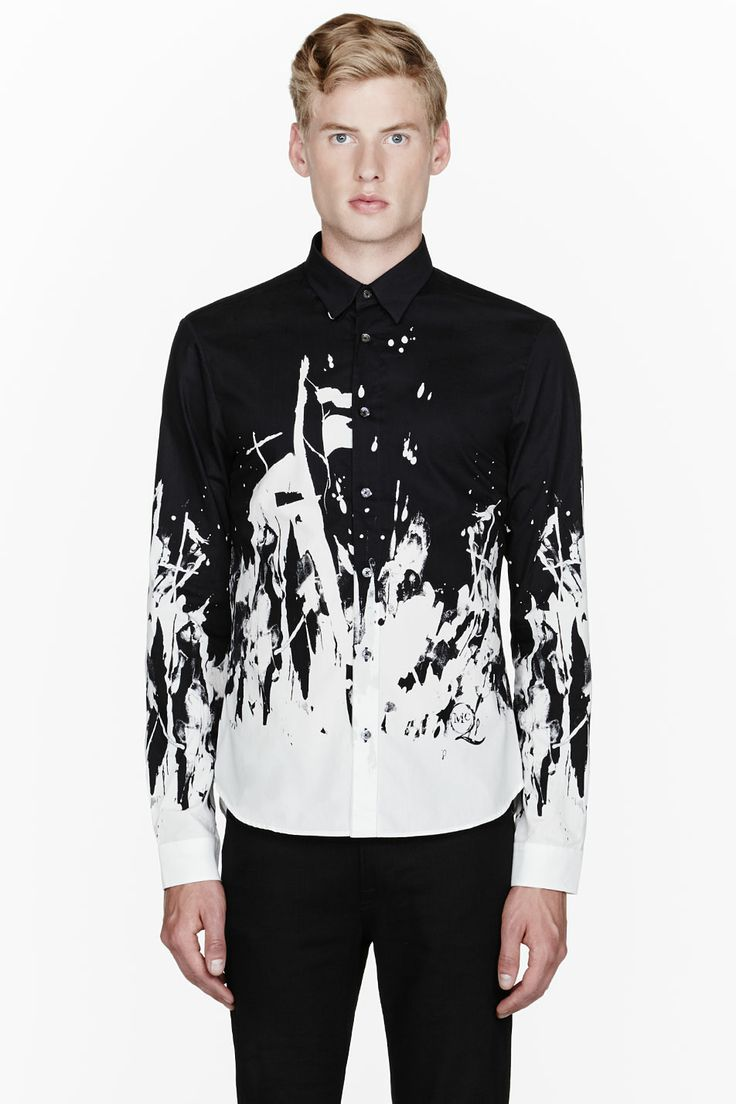 MCQ ALEXANDER MCQUEEN //  Black paint-splattered shirt  32114M028001  Long sleeve shirt in black. Spread collar. Button closure at front. Paint splatter effect dyed throughout lower portion in off-white. Shirttail hem. Tonal stitching. Single-button barrel cuffs with buttoned sleeve placket. 100% cotton. Machine wash warm. Imported.  $430 CAD