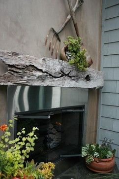 Small peach patio and side yard fireplace. Via Kelley and Company Home
