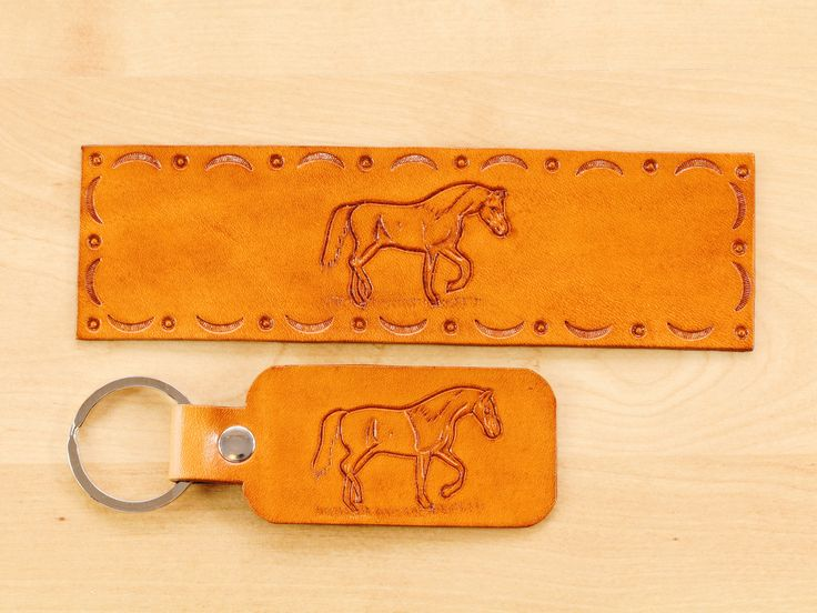 Click To Shop Now - Hand Carved Leather Horse Gift Set Hand Tooled Leather Keychain Horse Keychain Leather Bookmark Horse Bookmark. https://etsy.me/2E2IEKY #horse #giftset #keychain #leather #horsegiftset #handcarvedleather