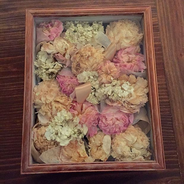 A DIY tutorial for preserving your wedding bouquet and styiling in a shadow box. An easy and inexpensive way to preserve all flowers. funyumandfrills.com
