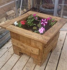 By the use of pallet to make a pallet planter is a very awesome idea as its look unique and simple. It's in square shape and there is many color and type of flower in it, which give a fabulous look to your Pallet planter. There is also a wooden pallet floor under this pallet planter