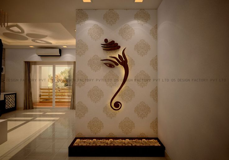 The main door of the apartment opens into the foyer, which though small came alive with some creative touches. The wall opposite to the foyer area became the focus and a backlit wood finish graphic Ganesha caught the eyes of anyone who entered the home.
