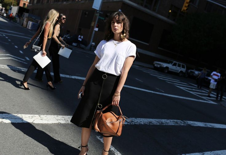 Irina Lakicevik wearing Céline and a Loewe bag:
