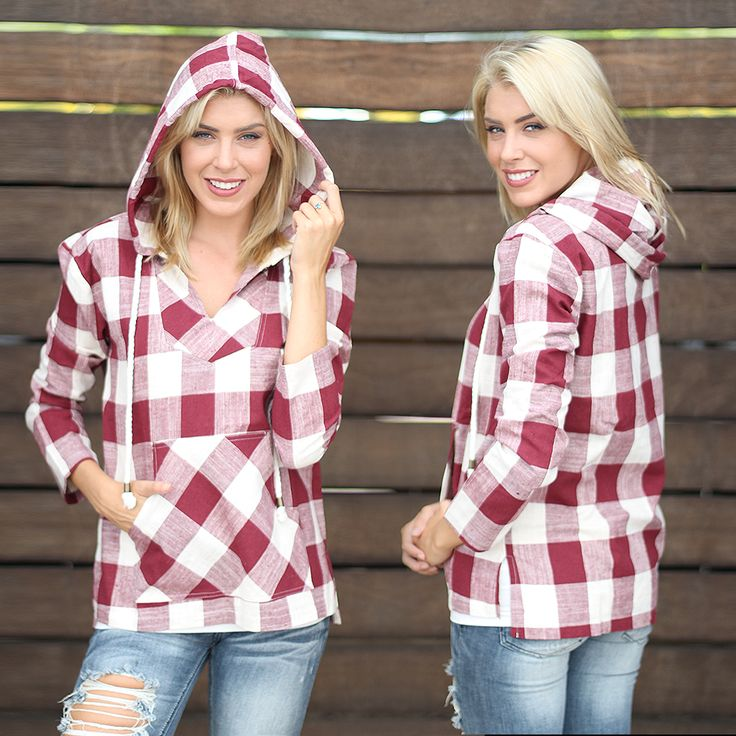 Stop what you are doing!! And fall in love with this Burgundy and Ivory Plaid Hoodie With Pocket! Sweet and simple burgundy plaid that goes with everything. Pair it with your favorite skinny jeans or faux leather leggings! Check out other cute tops at our trendy online boutique! Check out other cute tops at our trendy online boutique