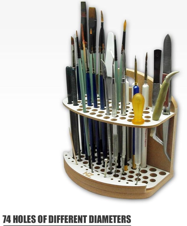 With our Brushes and Tools Holder you can safely store all kinds of modeling tools like brushes, drill bits, files, pincers, pipettes etc. It has 74 holes of different diameters which allows storing tools of different sizes and a convenient carrying handle. It is also possible to wall-hang the unit. Thanks to the compact Brushes and Tools Holder, your tools will always be at your fingertips.