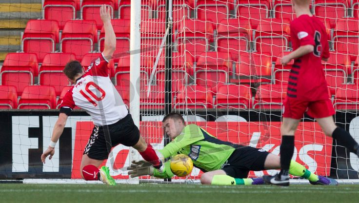 Queen's Park's keeper Wullie Muir saves at the feet of Clyde's David Gormley during the SPFL League One play-off game between Clyde and Queen's Par