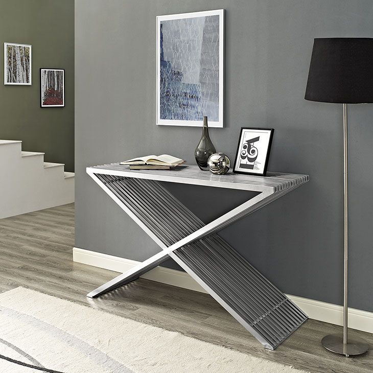 Press Console Table, Silver - Progress forward with the charged Press Console Table. Bolstered by a series of brushed aluminum segments, Press displays a mode of strategic progress amidst minimalist elements. Pleasing to the eye and resounding to your decor, keep your sights high while staying fully charged at all times. Perfect for contemporary living, entrance and lounge areas. Set Includes: One - Press Console Table. Material: 30*15*1.2mm 201 brushed stainless steel tube ,black adjustable…
