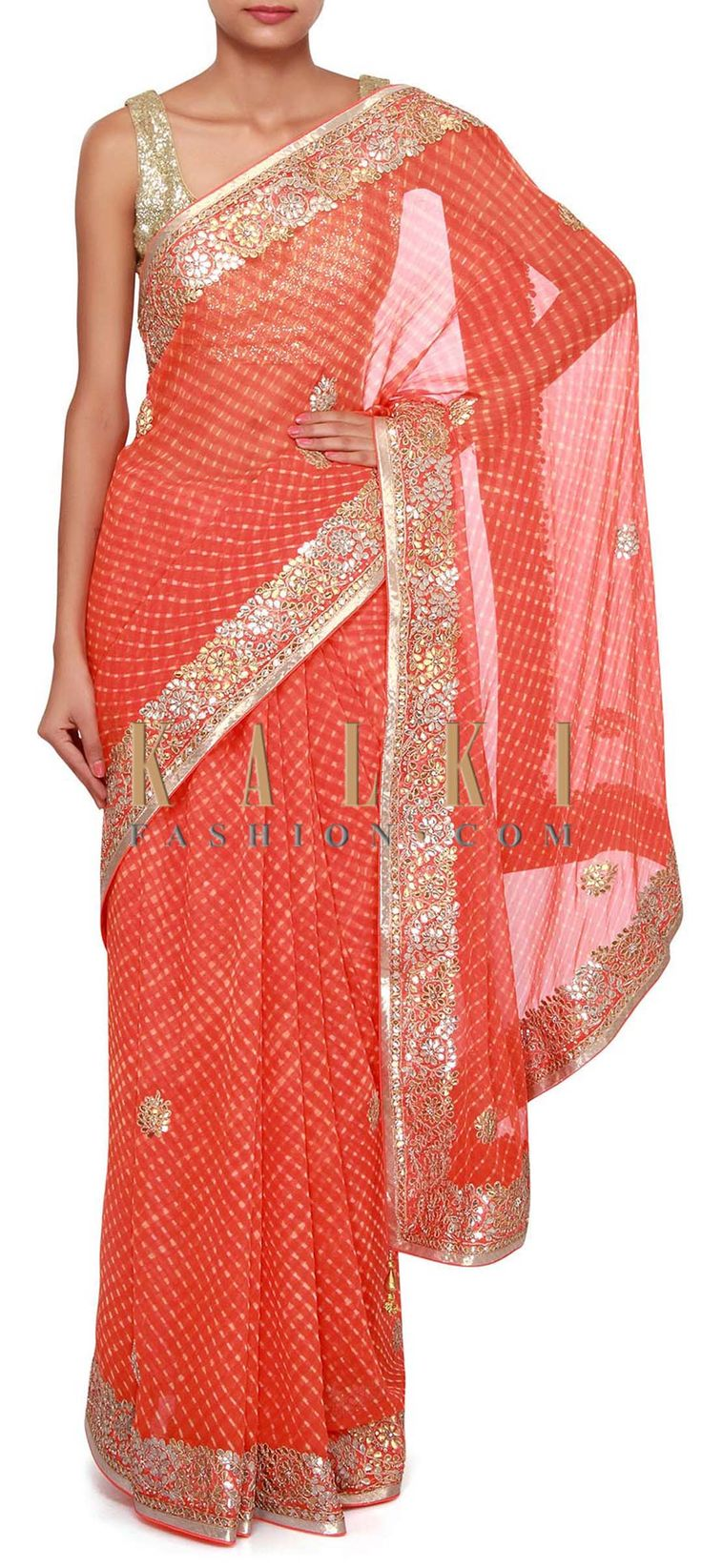 Buy Online from the link below. We ship worldwide (Free Shipping over US$100). Product SKU - 275632.Product Link - http://www.kalkifashion.com/orange-leheriya-saree-adorn-in-gotta-patch-border-only-on-kalki.html