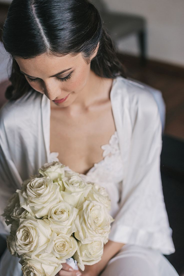 Love these fluffy white roses // Judd and Sonya's Classic White Bali Wedding