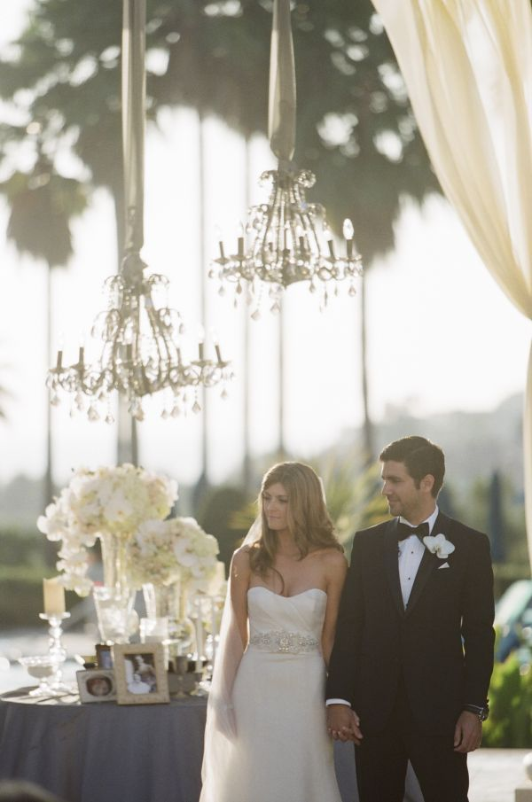Use tulle to hang chandeliers from tree branches, tent frame, or pavilion.