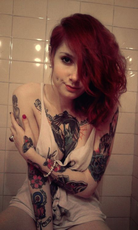 hotinkedgirls:    red head with cheek piercings #hotinkedgirls