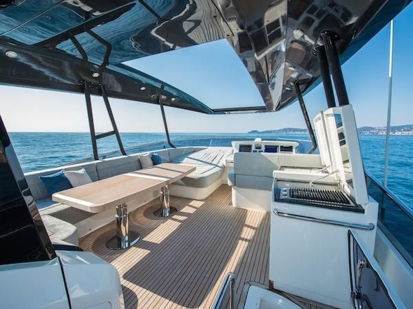 """This attractive Monte Carlo 76 """"Aurore"""" has a sleek metallic sky-blue hull and contemporary interior design."""