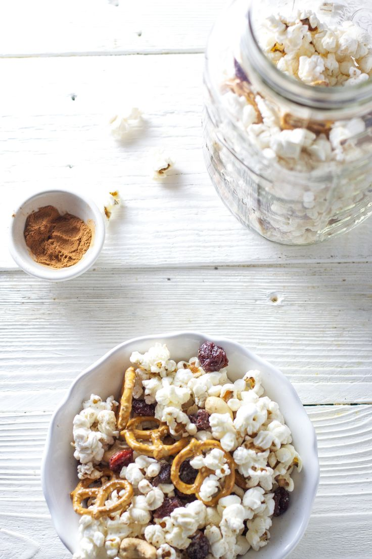 I fully intend to share this Popcorn Trail Mix with Ellie when she wakes up from her nap, that is if there is any left! I did have her in mind when making this delicious snack, but I had to taste it and then that was that, I have been sitting here on the counter ever since just munching away on this highly addictive and totally healthy snack mix. My biggest debate going on in my mind right now is if I should pair this snack with a glass of water or wine! It's 5'oclock somewhere, ...