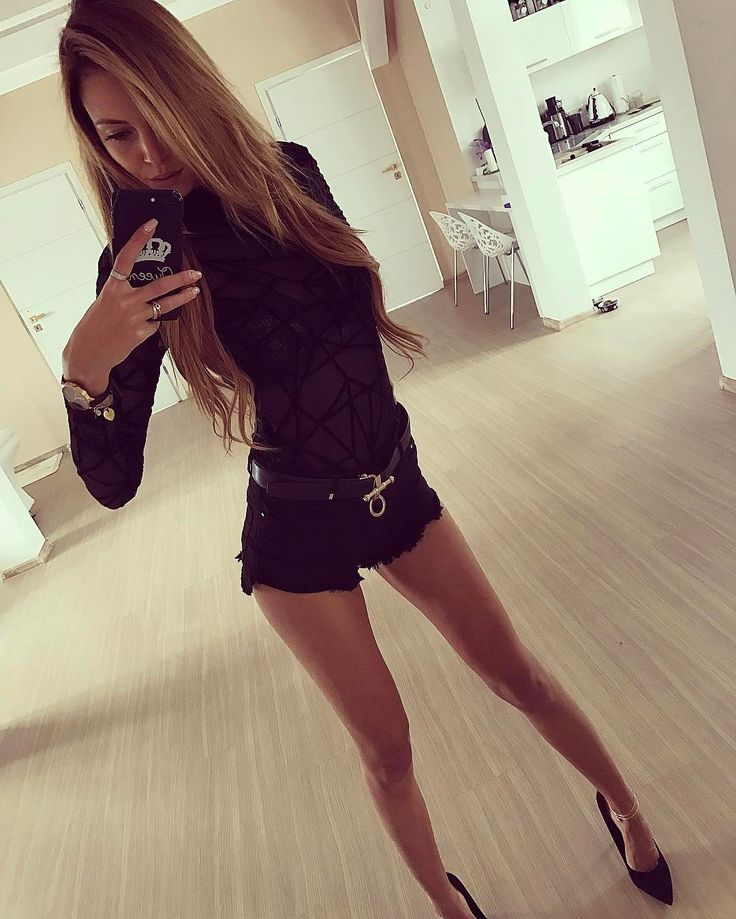 Hot Polish model and beauty specialist Karolina Karolczak looking sexy in stylish body with tiny denim shorts and belt. #polishmodel #polishgirl #polishbeauty