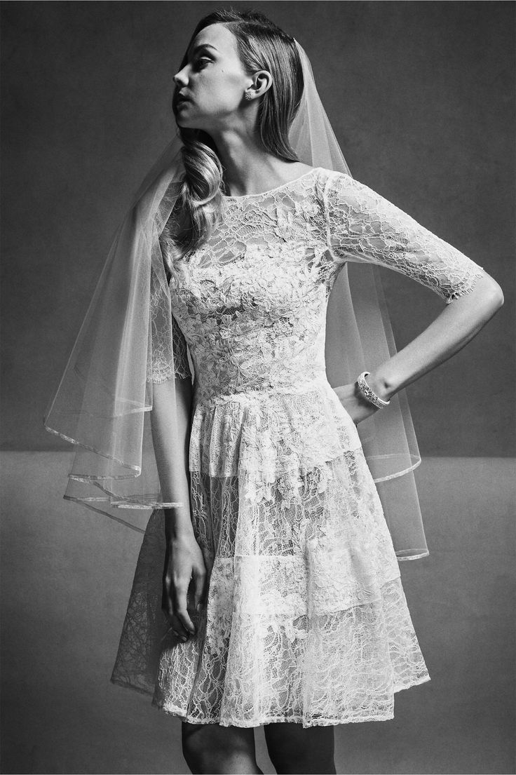 Vintage-y lace panels. Old school but makes it new-school with the modern-ish veil. Barletta Dress from BHLDN. The New Sleeve trend.
