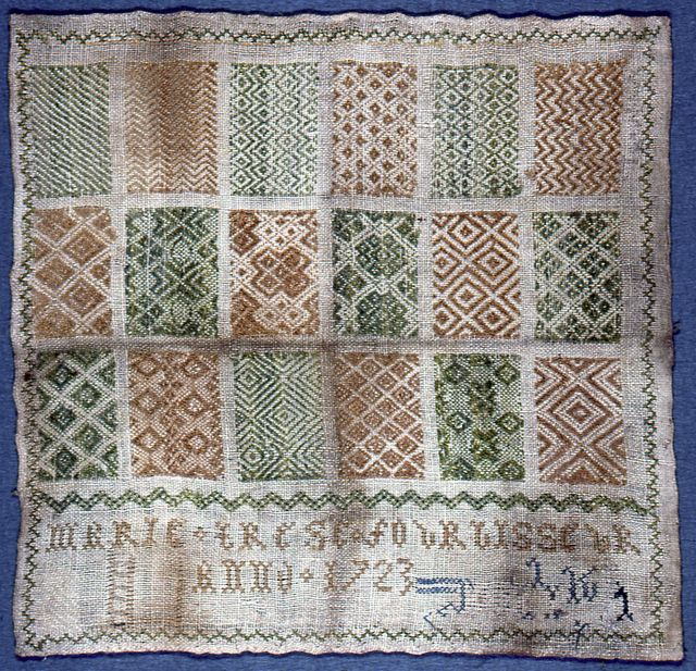 """Eighteen examples of pattern darning in a grid arrangement signed """"Marie Terese Fourbisseur. Anno 1723."""" Silk and linen embroidery on linen foundation technique: spaced running (pattern darning), four-sided and cross stitches on plain weave foundation. darning interlaces in one direction only."""