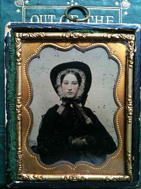 rose ruby ambrotype of a pretty lady - I do not understand what is going to on with her bonnet