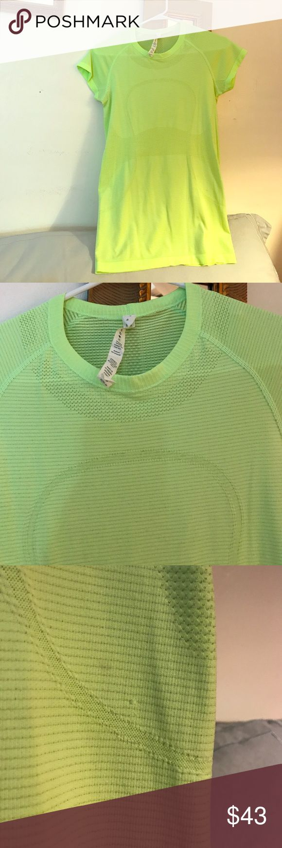 Lululemon Bright green or lime green top in great condition one small snag and mark but can be remove. lululemon athletica Tops Tees - Short Sleeve