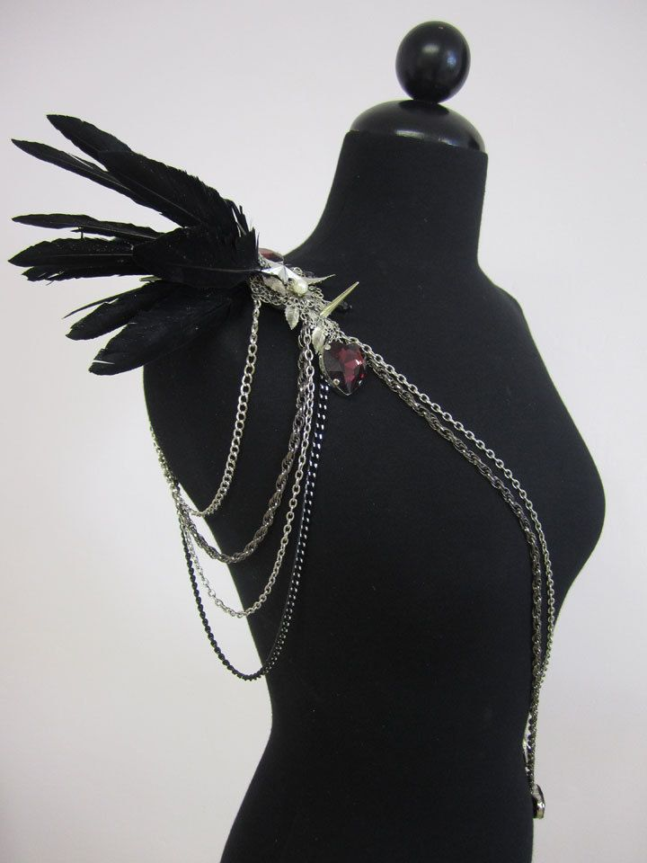 Limersion wings, like the jewelry too.  RAVEN Black lrg feather epaulet w/ spikes and heart gems
