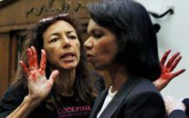 Code Pink member Desiree Anita Ali-Fairooz, pictured here confronting Secretary of State Condoleezza Rice over the Iraq war, has been convicted of being disruptive at US Attorney General Jeff Sessions' confirmation hearing. (AP/Charles Dharapak)