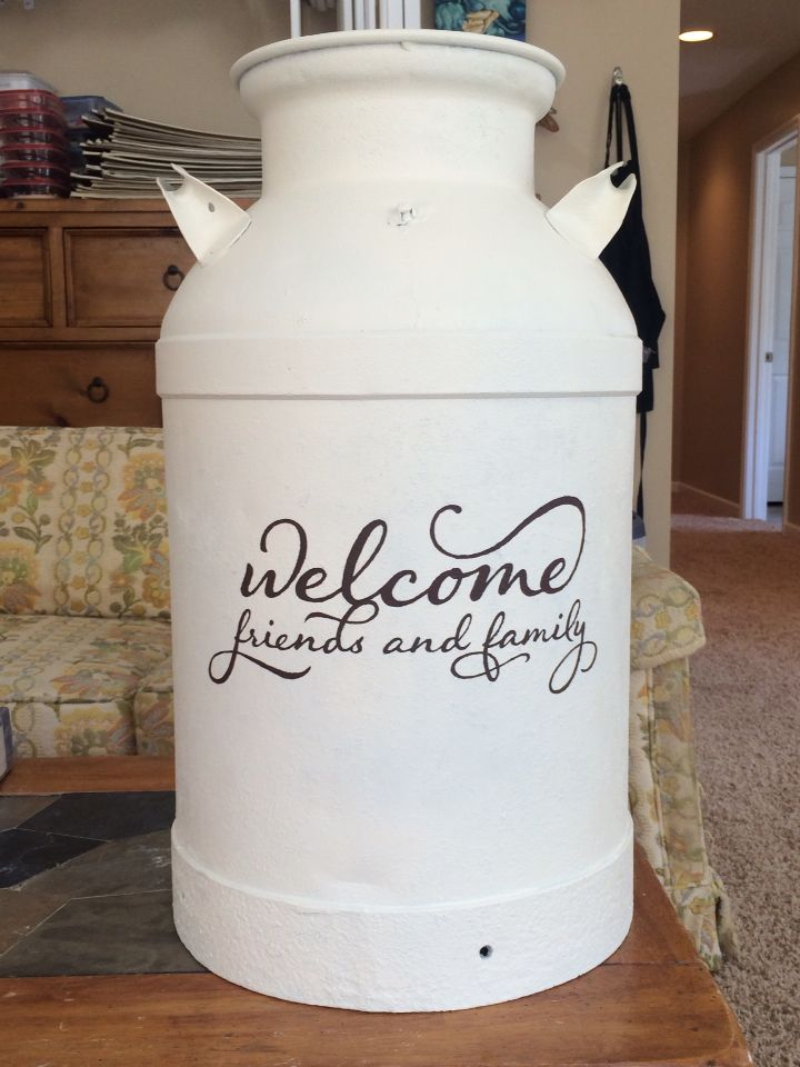 Painted milk can to be used as umbrella holder on porch