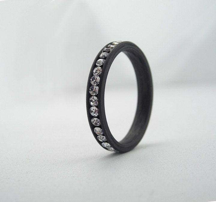 This could be a kickass wedding band. Carbon Fiber jeweled engagement Eternity Ring. $300.00, via Etsy.