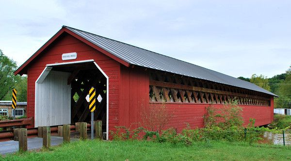 The Paper Mill Village Bridge, also called the Paper Mill Bridge or Bennington Falls Covered Bridge, was built by Charles F. Sears and named for an adjacent 1790 paper mill, one of Vermont's first such mills.