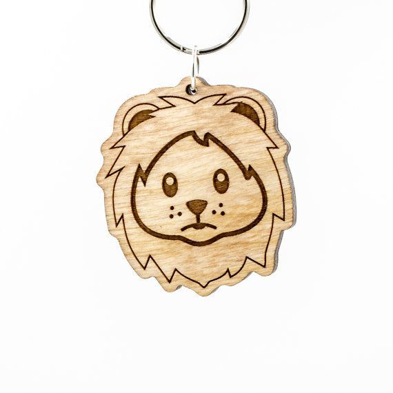 Wooden lion face emoji. More cuddly than fierce, this is the lion emoji, also known as cute lion emoji or timid lion emoji. Of course hes also known as the King of the Jungle! This little fella is made of 1/4 (6mm) thick birch ply, which has been laser cut for precise detailing. He has