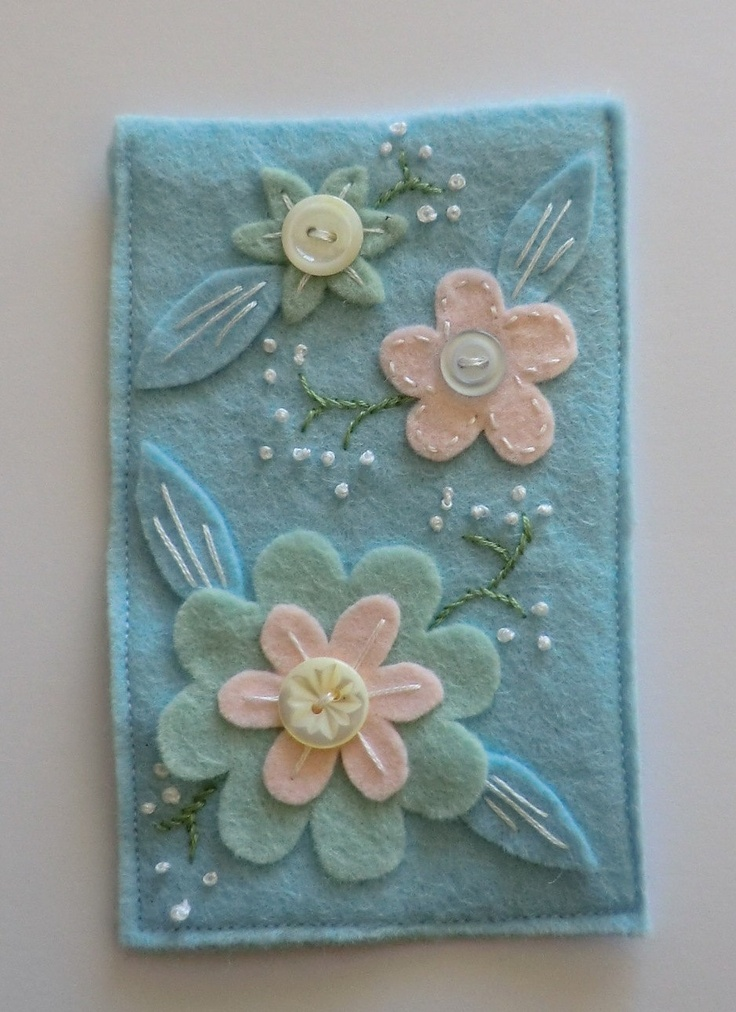 felt flower and mother of pearl button hand embroidered mobile cosy. £7.50, via Etsy.