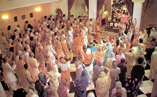 Devotees blissfully chanting Hare Krishna and making some tangible spiritual progress
