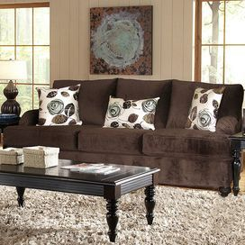"Chocolate-hued sofa. Made in the USA.  Product: SofaConstruction Material: Solid kiln dried wood, engineered wood, foam, and polyesterColor: ChocolateFeatures:  Includes three throw pillowsMade in the USA Dimensions: 40"" H x 92"" W x 40"" D"