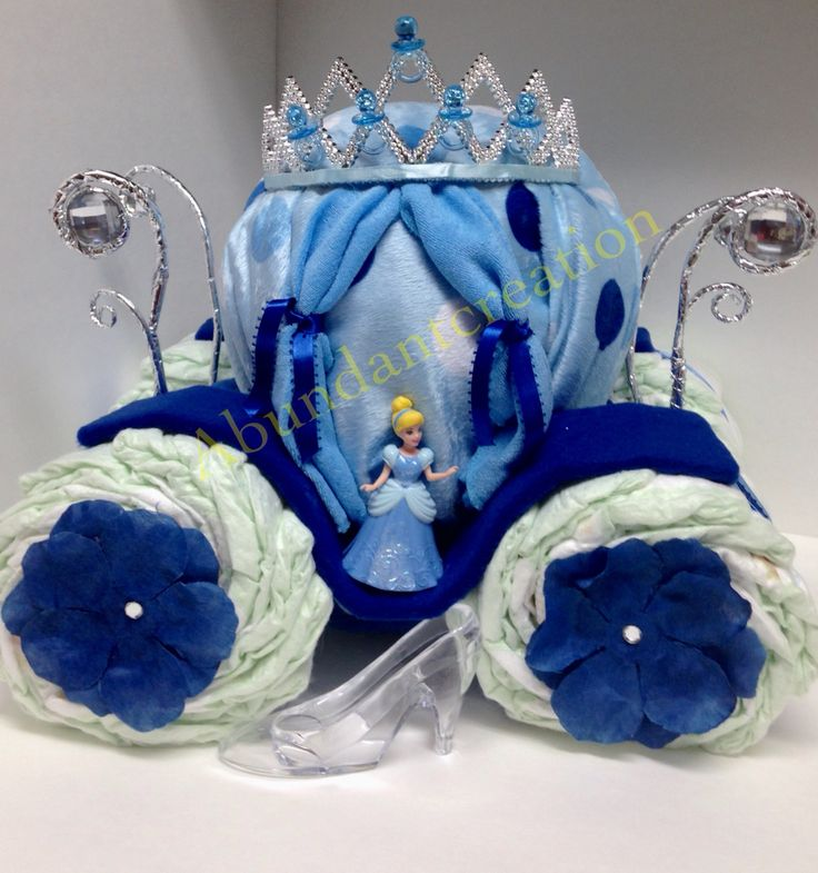 Cinderella Diaper Cake. Cinderella, Cinderelly or Ellla she is going to the ball. This gorgeous carriage will take a ride to a baby shower. Blanket, washcloths  and diapers completes this gift.