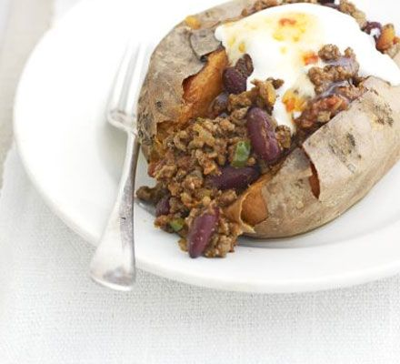 Baked sweet potatoes with easy chilli & soured cream.   Use turkey and greek yogurt