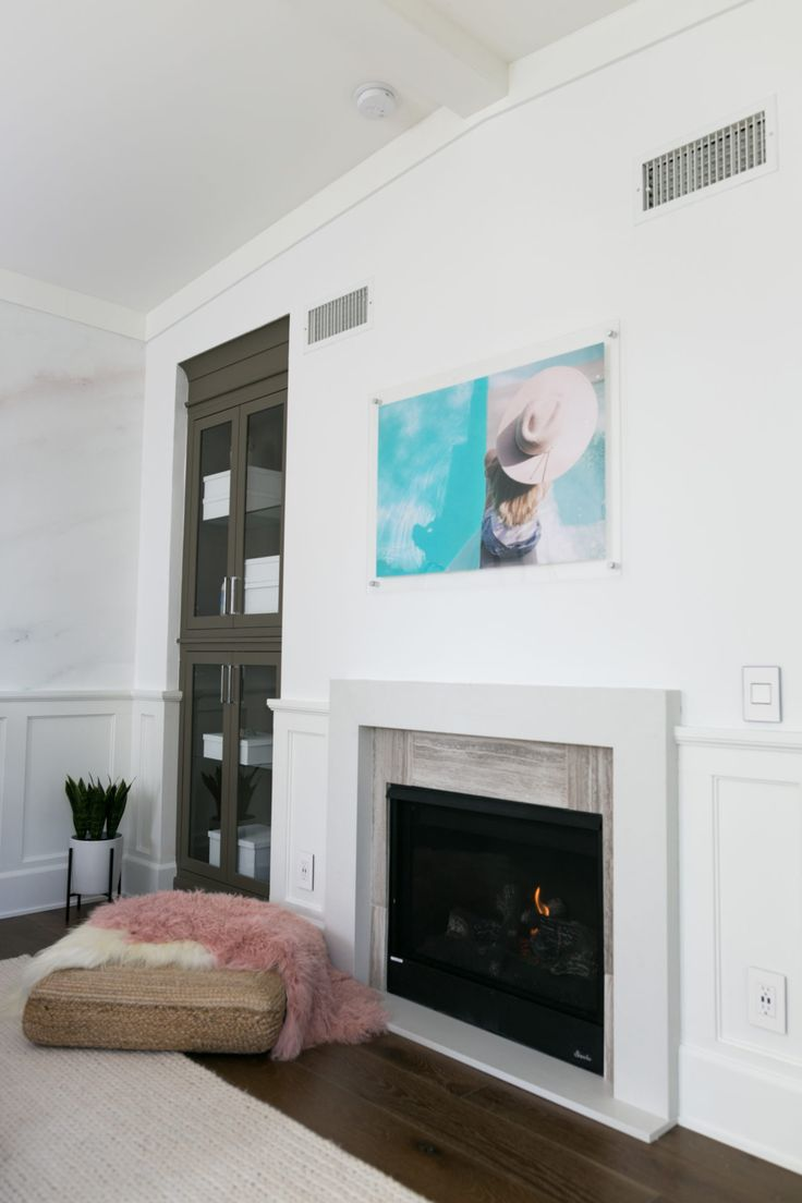 A fireplace, custom photography, and floor cushion? What else could a bedroom need?!
