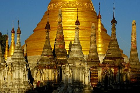 Bas of a big golden stupa with many small stupas in front Pindaya Shan State Burma