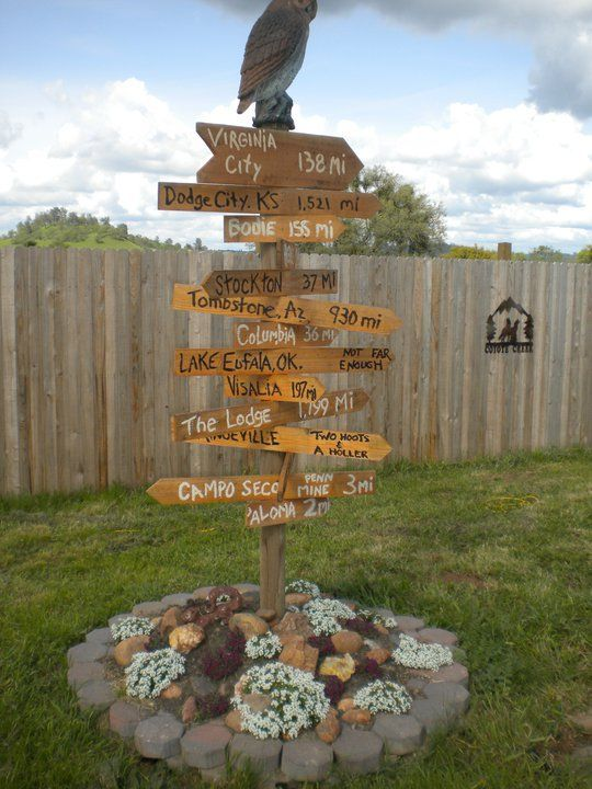 Directional sign in Outdoor Adventure Area - using local town & destination names