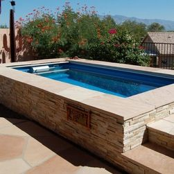 camouflaging above ground pools endless pools original endless pools textured stone coping - Above Ground Fiberglass Lap Pools