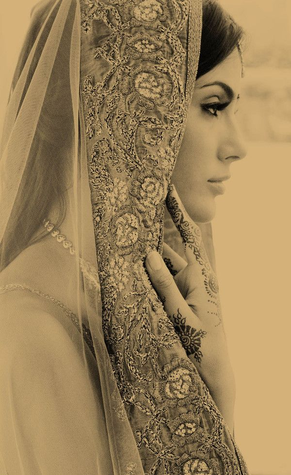 Indian Wedding. I love the henna on her hands.