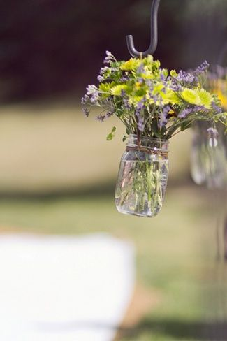 DIY Colorado Rocky Mountain Ranch Rustic Wedding | Confetti Daydreams -  Get the DIY tutorial for these hanging mason jars filled with flowers and water, which were displayed at the wedding ceremony and reception ♥ #DIY #Ranch #Rustic #WeddingTheme
